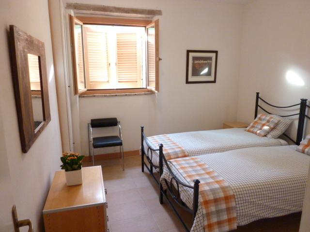 The second bedroom offers large twin beds