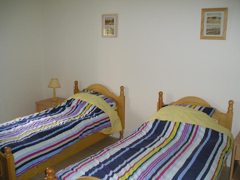 The rear twin-bedded room