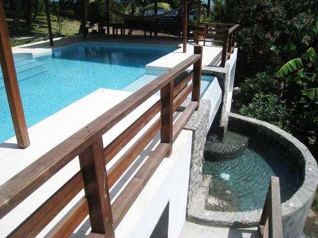 An ideal angle showing the Grand Pool with the waterfall and kids pool / jacuzzi below