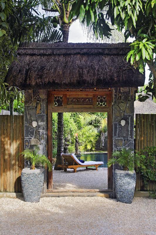 Our Javanese door between garden and private parking area