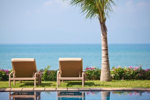 Relax on your sunbed whilst enjoying the serene blue waters