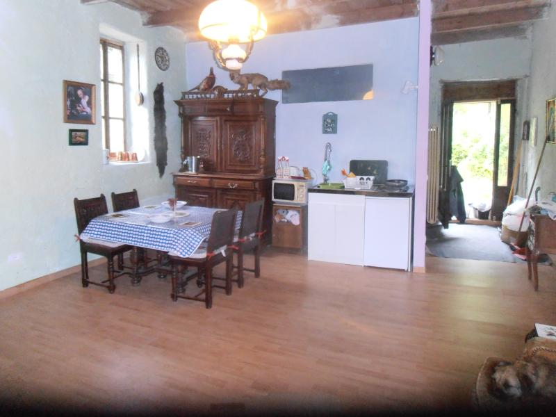 DINING AREA WITH FRENCH FURNITURE AND KITCHENETTE WHERE YOU CAN EAT PAST AND LISTEN TO NATURE