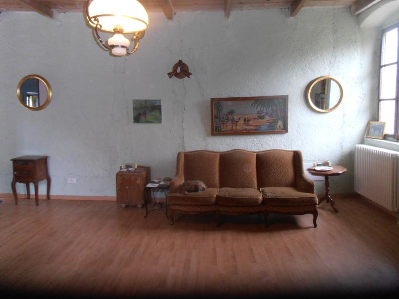 FRENCH FURNITURE AND ITALIAN VIEWS OF THE LAKES AND MOUNTAINS SPREAD OUT AND HAVE AN APERATIVO