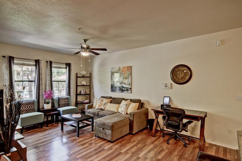 Plenty of natural light, hardwood laminate floors, and sleeper couch