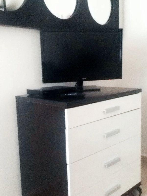 26' LCD TV and blu ray player in master bedroom