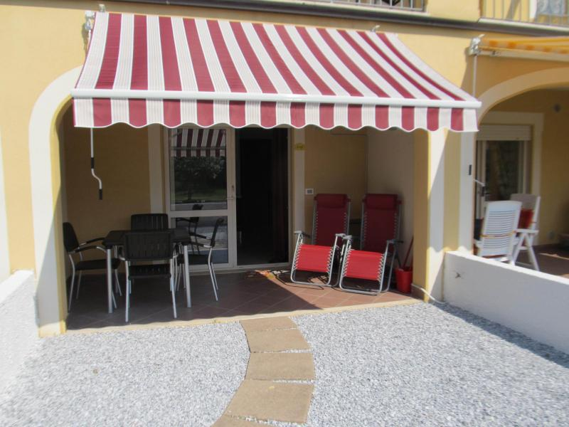 Terrace area with shaded awning and garden furntiure