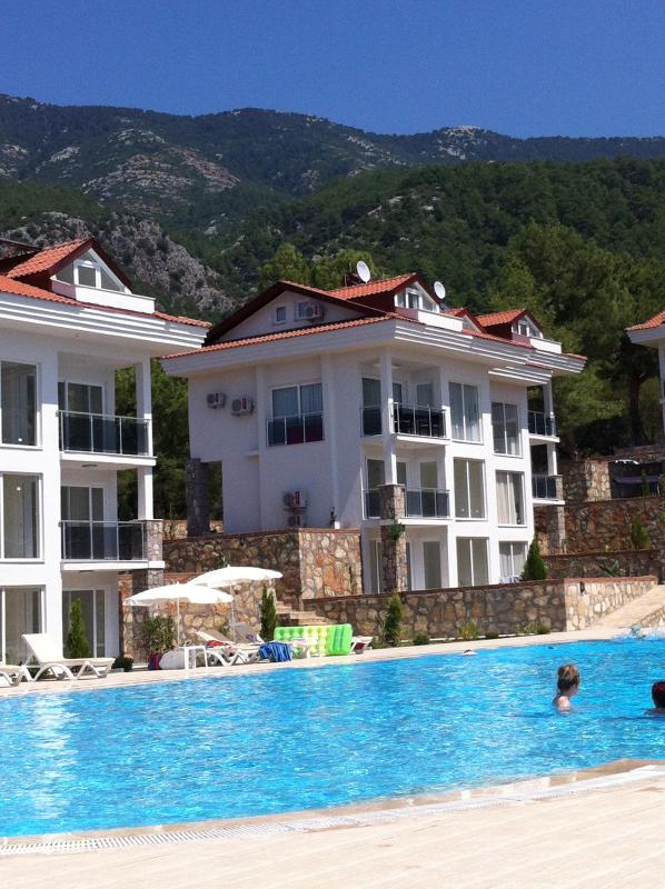 Our apartment in Orka Gardens, nestled at the foot of the mountains with its 25m pool