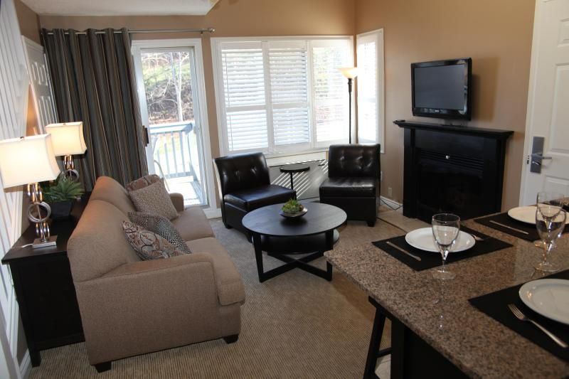 Bright and airy Living Room with fireplace and flat panel TV.