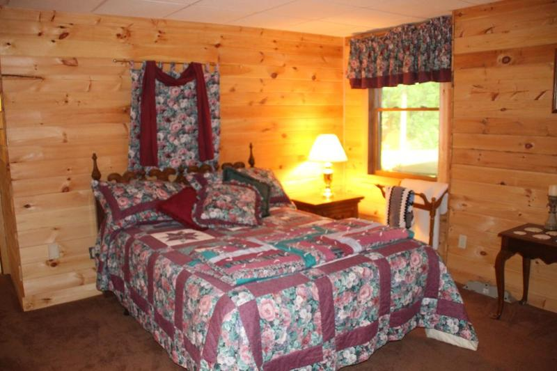 Shagbark Room is a large bedroom with a queen bed.