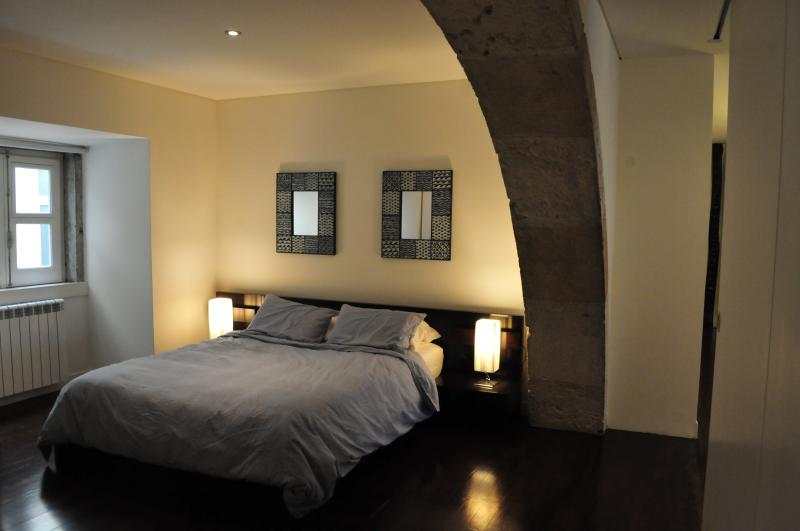 Master Bedroom with Primuvo linens and light summer duvet cover