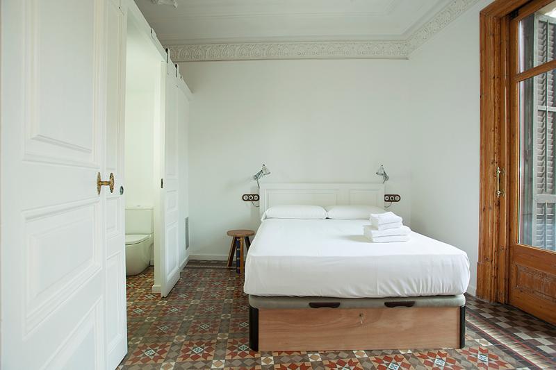 Room 1 with en-suite bathroom and balcony. Luxury queen size bed.