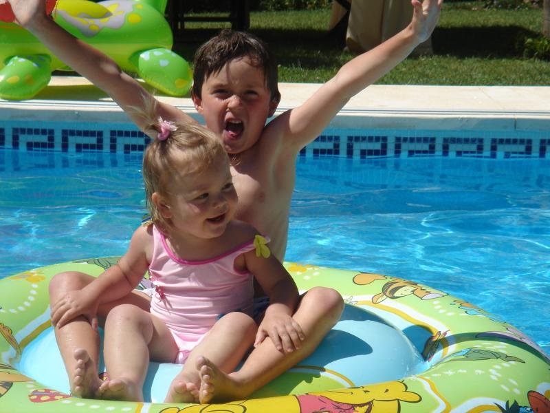 Sofia and Christian enjoying the pool