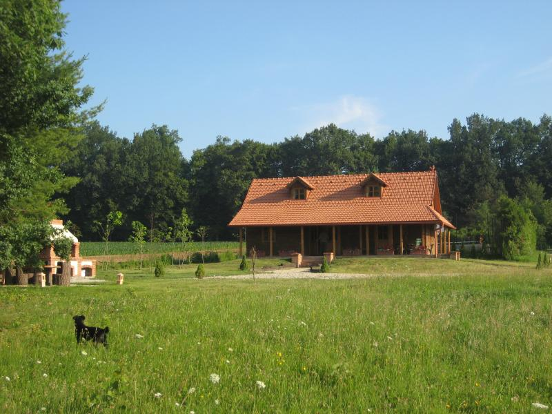 Traditional oak house set in forest and fields