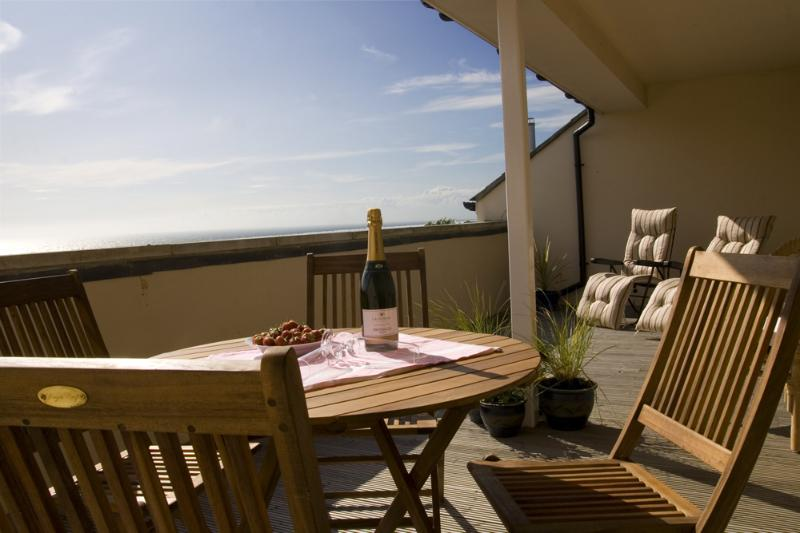 Large balcony overlooking the sea with a view of 180 degrees
