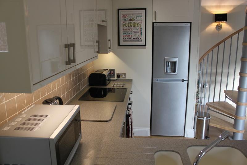 Modern kitchen with corian worktops, fridge freezer, oven,hob,microwave,dishwasher & washing mac
