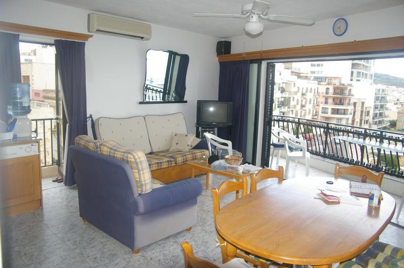 View of two balconies from living room/kitchen