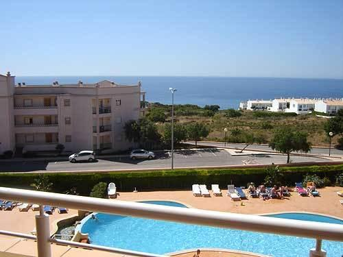 The south-facing apartment overlooks the pool area and has lovely Sea Views!
