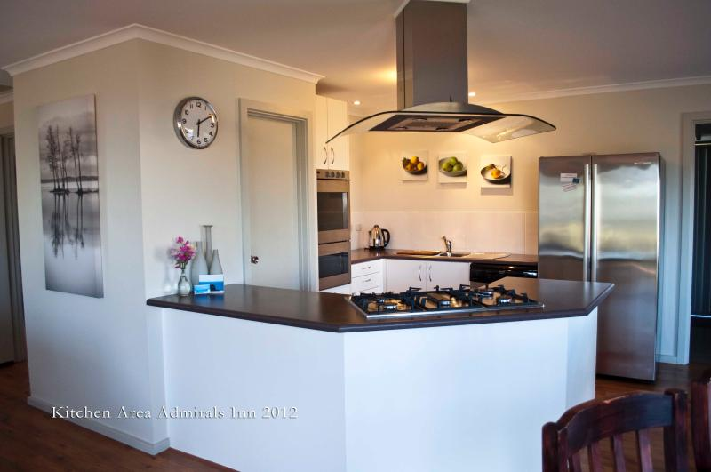 Modern Kitchen with all your cooking needs, fridge, freezer, micro wave oven and dishwasher