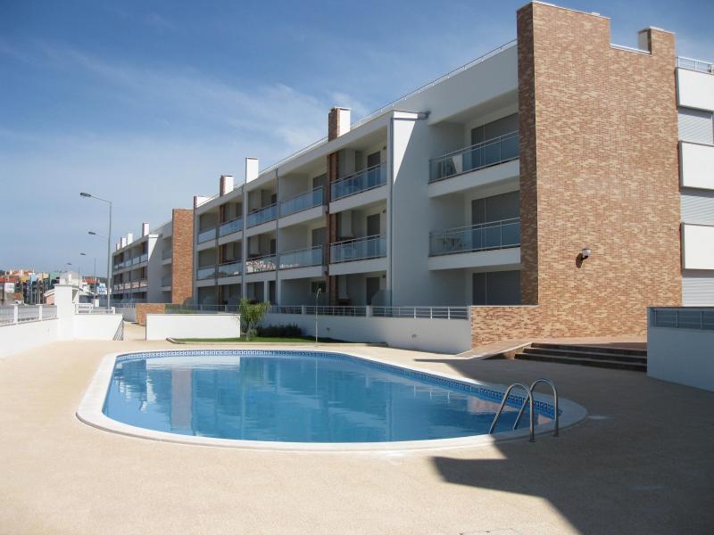 Appartement van zwembad-kant