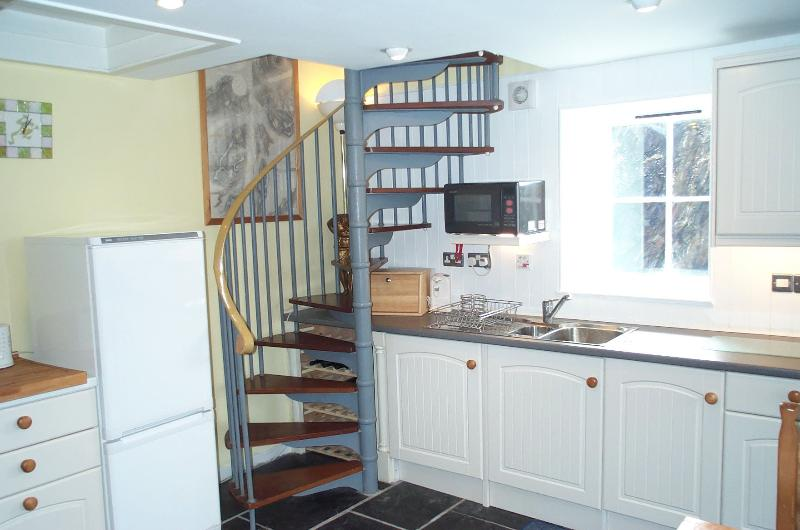 Spiral staircase from kitchen up to very private chartroom and spare bedroom for seventh person