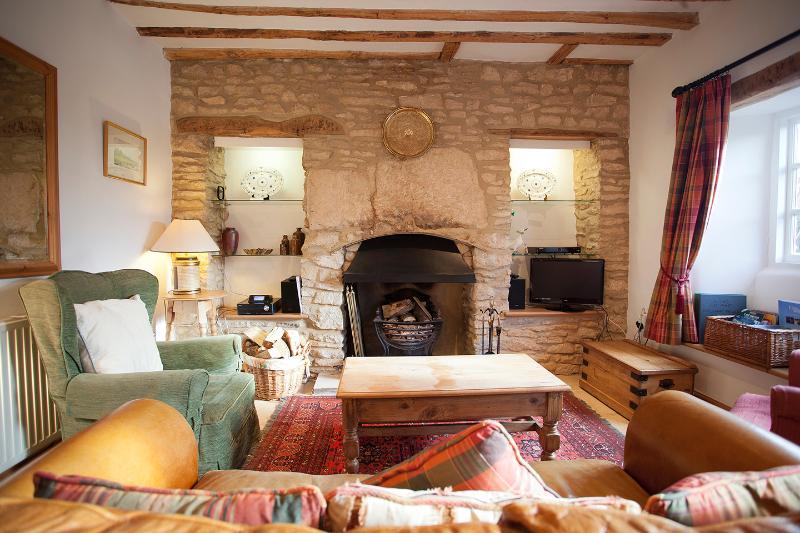 Lounge with log burner, TV/DVD/Freeview, Gigajuke hi-fi.