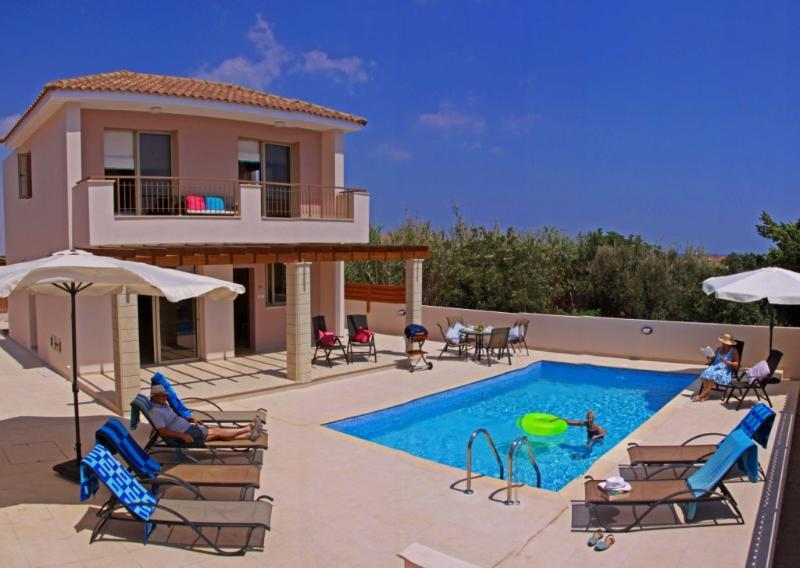 Large outside pool area with plenty of sun loungers, seating & shady umbrellas