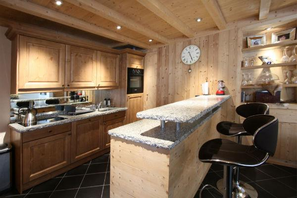 Breakfast bar and open plan modern, fully-equipped kitchen