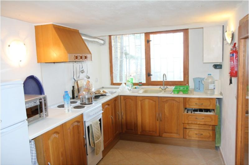 The large kitchen has cooker fridge-freezer and microwave as well as a view over the valley