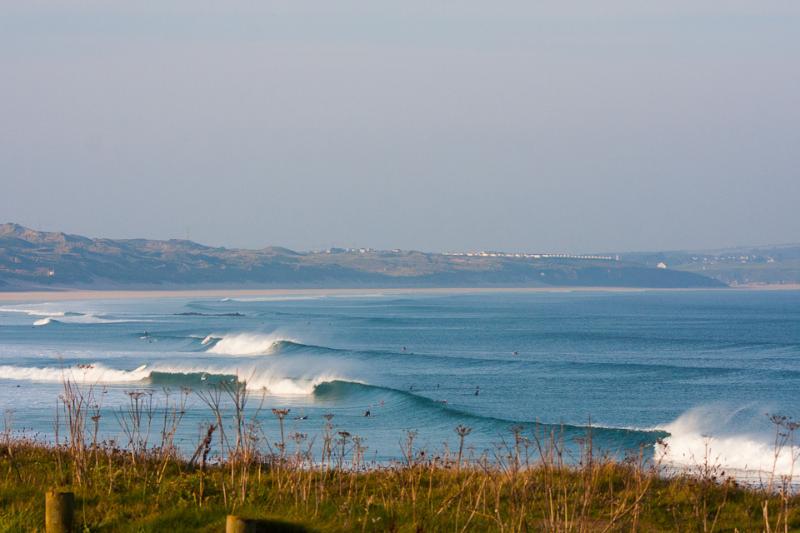 Waves crashing along the shore of Gwithian Beach.