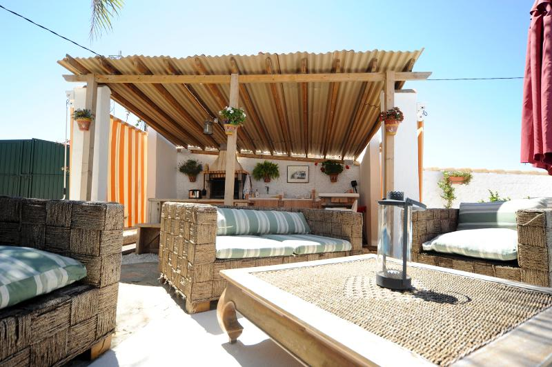 Summer kitchen and loungers by the pool