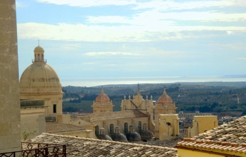 A postcard special on the town and the Cathedral of Noto from your balcony