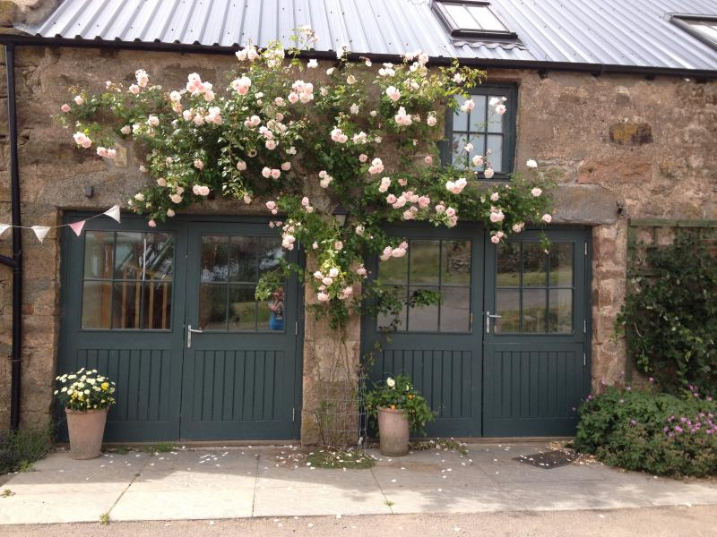 The Hayloft in summer. Entrance is by the left hand door.