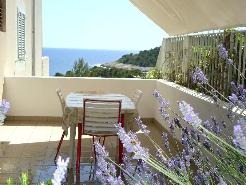 Private terrace (18 square meters large) with side sea view