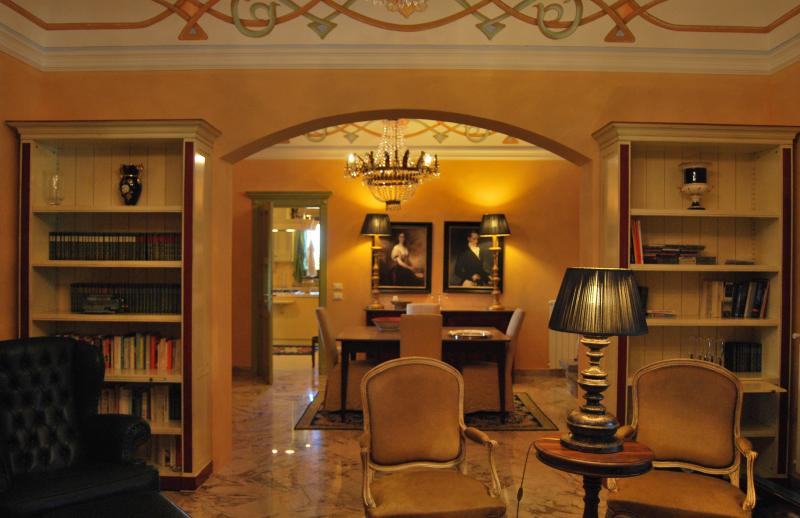 living and dining room with frescoed ceilings