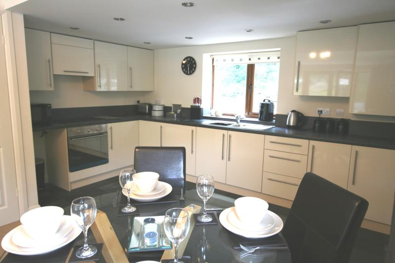 Fully fitted kitchen with integrated appliances and spacious dining area.