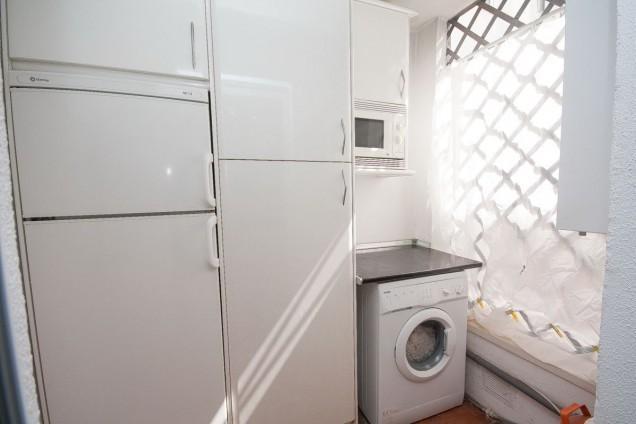 Utility room off kitchen, additional fridge, freezer, microwave and washing machine