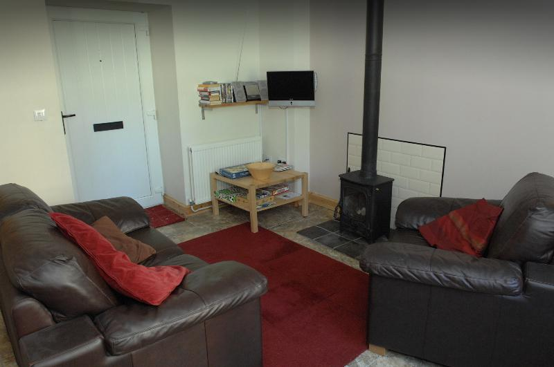 lounge with log burner and tv/ dvd player