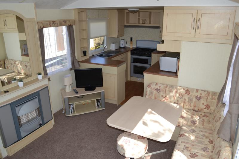 Spacious lounge, seating and kitchen area