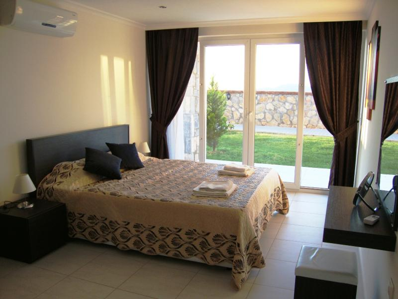Double room with king size bed & patio doors to the rear terrace