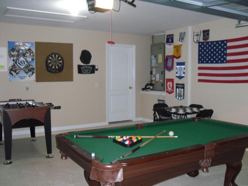 Games room equipped with pool table, dart board and foosball table