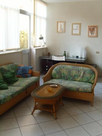 living room with access to the veranda