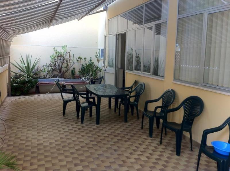 large veranda with table and chairs