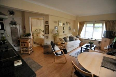Cosy  comfortable sitting/ dining kitchen area with two large windows lovely bright and airy
