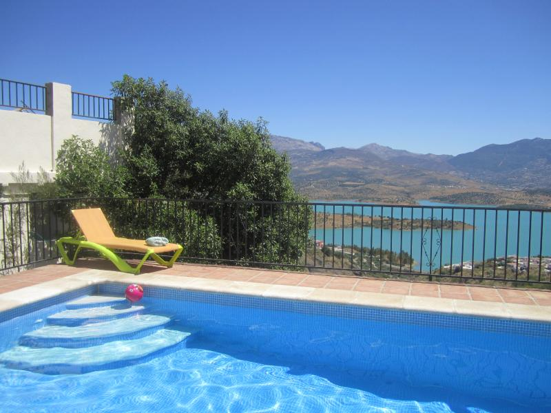 Pool with fantastic views having  graduated steps for easy access, some pool toys are provided.