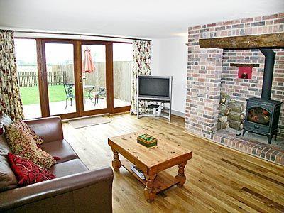 Large lounge with wood burner and big TV