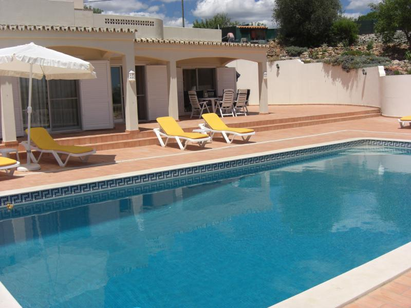 Sunshine - Pool, Loungers, Umbrellas on the Patio, Casa with Doors to Bedrooms and Lounge