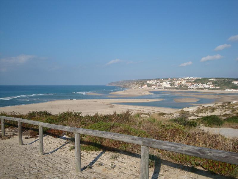 10 minutes walking  a  long laguna and beautiful beach!  surf, walking, pooll,golfing,fishing, walk!