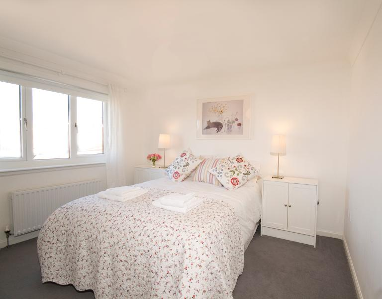 The pretty upstairs double bedroom with king-size bed and John Lewis mattress