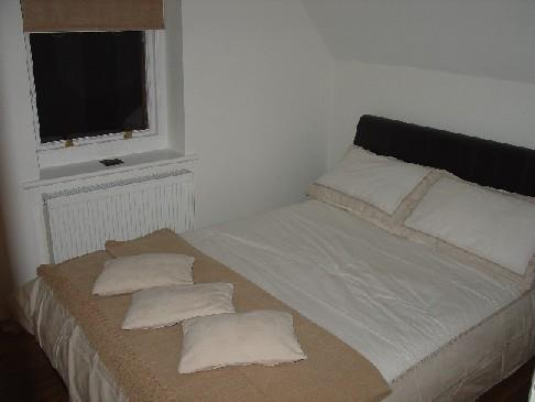 Second bedroom with double bed & contains stylish storage areas including wardrobe