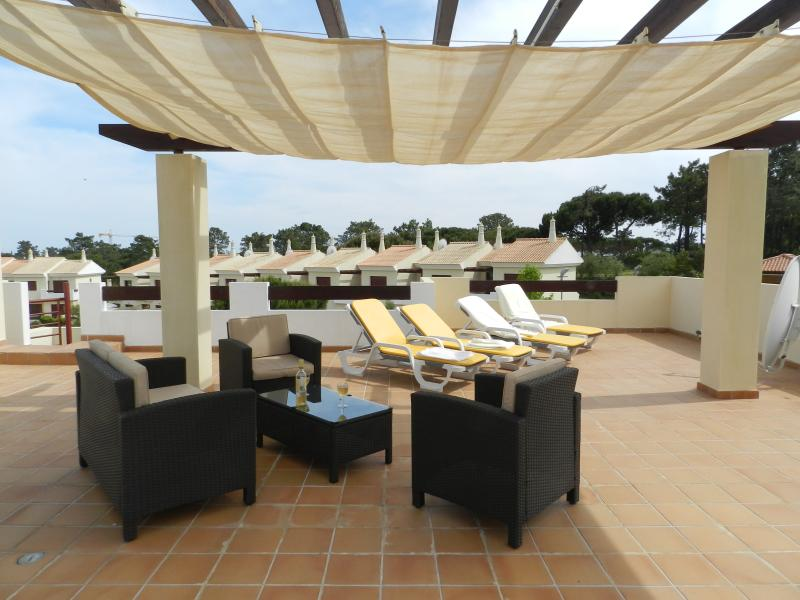 Stunning roof terrace, 'chill-out' on the rattan sofa and chairs.